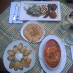 fried courgettes and grilled feta (starters), pita bread, and selection of meat (Poseidon platte