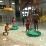 Family playing in the indoor waterpark at Wilderness on the Lake.