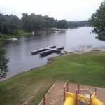 View of lake from 2nd floor unit balcony. Pool and beach to the right.
