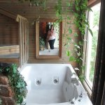 Love the tub. There is also a shower open to the window on the other side.