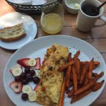 Omelet with sweet potato fries and mimosa and coffee.