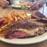 Reuben with shoe string fries & cheese steak sandwich with potato salad