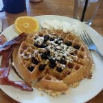 Waffle with blueberries and walnuts.