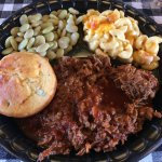 Pulled pork with sauce, Lima beans, Mac n cheese and corn bread.
