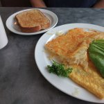 Bacon and Cheese Omelet with Avocado, Hash Browns and Wheat Toast