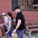 Nick, our guide, showing us a commemorative plaque in Little Italy