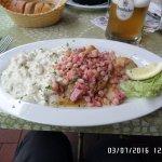 Pan fried fish, bacon cubes, potato salad.