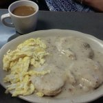 Egg & gravy biscuits ... Lookit the SIZE! $5...wow...good cooking, peppery gravy