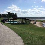 The photos include the beach area, pool and little park.