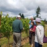 Fred explaining Pinot grapes to our group.