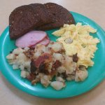 Cinnamon roll. 2 eggs, canadian bacon, home fries, and rye toast. Tuesday special. Home fries.