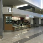 Located on the concourse adjacent to United Airlines Gate 70 inside secure area.