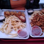On the left, fried oysters and fries. On the right, fried clams and fries.