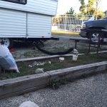 my camper / sewer pipe, viewed from next camp site... their picnic table and patio very close