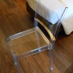 Clear plastic desk chair. Hard and sweaty.