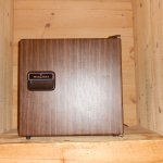 small refridge in a self built wooden box.