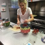 Staff preparing breakfast fruit salad