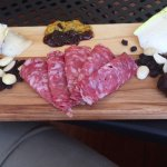 cheese and charcuterie with nuts, spicey plum chutney, whole grain mustard, dried fruit