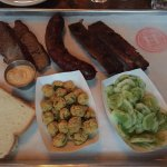 BBQ Trio (clockwise from upper left): Brisket, sausage, ribs, cucumber salad, fried okra, bread