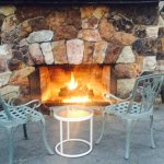 Outdoor fireplace for guests to enjoy on a cool evening