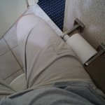 Toilet paper roll holder juts out where your leg should be.