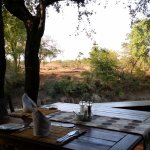 Deck dinning with view of waterhole