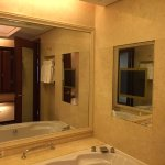 The surrealistically gigantic OYC Hotel in Zhaoquing - large bathroom with TV