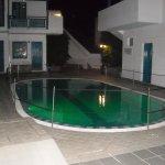 Small pool at night (closed).