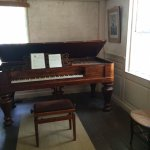 very rare and fully functioning piano in the parlour