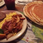 Breakfast! Pancakes, eggs, sausage, and home fries.