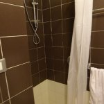 Small shower with a curtain - yuk!