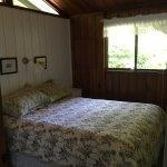 Queen sized bed in the main bedroom.