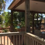 Cottage #9 patio us adjacent to pool. BBQ grill & table w/2 chairs provided