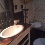 vintage vanity and deep clawfoot tub