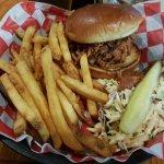 pulled pork sandwich, fries, slaw