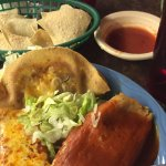 Cheese enchilada, beef taco, beef tamale with little red sauce, with quac/sour cream
