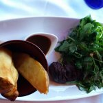 Steak Frites, wilted arugula, sliced tenderloin