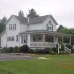 The house sits right on the main road. Plenty of parking available.