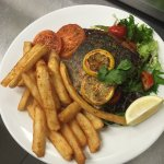 The Crispy-Skin Grilled Barramundi served with a garden salad and beer-battered chips. Delicious