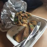 Vegan burrito and potato wedges (defs worth adding to your meal)