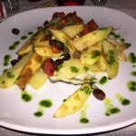 Baked turbo fillet with potatoes and olives