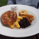 delicious pork with red cabbage, parsnip chips and baked apple