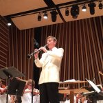 Conductor performs with cabaret soloist