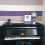 piano in communal living room