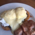 Poached eggs on potato rosti with parmesan creme