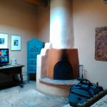 Kiva fireplace, lovely heavy Santa Fe decor, our own small courtyard. In love with this room.