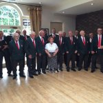 Ceiriog male voice choir singing in Welsh overlooking the bowling green.