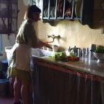 Cooking Class: Elena at sink in her kitchen