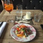 Children's size Margherita pizza with extra toppings. Boquerones small plate. Aperol Spritz and