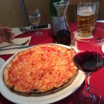 Delicious pizza, wine and beer
